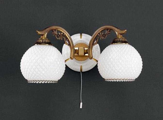 Бра A 8605/2Настенные и бра<br>A 8605/2. Бренд - Reccagni Angelo. тип лампы - накаливания или LED. количество ламп - 2. тип цоколя - E27. мощность - 60. цвет арматуры - бронзовый. цвет плафона - белый. материал арматуры - латунь. материал плафона - стекло. высота - 170. ширина/диаметр - 390. длина - 220. степень защиты ip - 20. форма - круг. стиль - классический. страна происхождения - Италия. напряжение - 220.<br><br>Бренд: Reccagni Angelo<br>тип лампы: накаливания или LED<br>количество ламп: 2<br>тип цоколя: E27<br>мощность: 60<br>цвет арматуры: бронзовый<br>цвет плафона: белый<br>материал арматуры: латунь<br>материал плафона: стекло<br>высота: 170<br>ширина/диаметр: 390<br>длина: 220<br>степень защиты ip: 20<br>форма: круг<br>стиль: классический<br>страна происхождения: Италия<br>напряжение: 220
