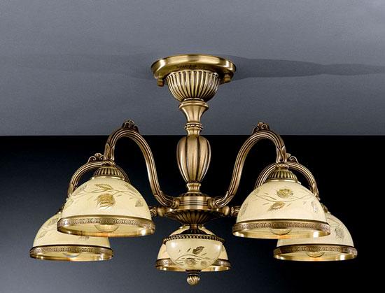 Потолочная люстра на штанге PL 6228/5на штанге<br>PL 6228/5. Бренд - Reccagni Angelo. тип лампы - накаливания или LED. количество ламп - 5. тип цоколя - E27. мощность лампы - 60. цвет арматуры - бронзовый. цвет плафона - бежевый. материал арматуры - латунь. материал плафона - стекло. высота - 360. ширина/диаметр - 620. форма - круг. стиль - классический. страна происхождения - Италия. напряжение - 220.<br><br>Бренд: Reccagni Angelo<br>тип лампы: накаливания или LED<br>количество ламп: 5<br>тип цоколя: E27<br>мощность лампы: 60<br>цвет арматуры: бронзовый<br>цвет плафона: бежевый<br>материал арматуры: латунь<br>материал плафона: стекло<br>высота: 360<br>ширина/диаметр: 620<br>форма: круг<br>стиль: классический<br>страна происхождения: Италия<br>напряжение: 220