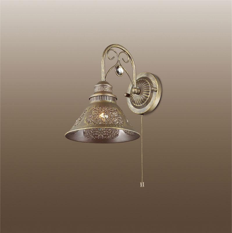 Бра 2843/1W Odeon LightНастенные и бра<br>2843/1W ODL16 153 коричневый с патиной/декор хрусталь Бра с выкл. E14 40W 220V KAMUN. Бренд - Odeon Light. материал плафона - металл. цвет плафона - коричневый. тип цоколя - E14. тип лампы - накаливания или LED. ширина/диаметр - 190. мощность - 40. количество ламп - 1.<br><br>популярные производители: Odeon Light<br>материал плафона: металл<br>цвет плафона: коричневый<br>тип цоколя: E14<br>тип лампы: накаливания или LED<br>ширина/диаметр: 190<br>максимальная мощность лампочки: 40<br>количество лампочек: 1