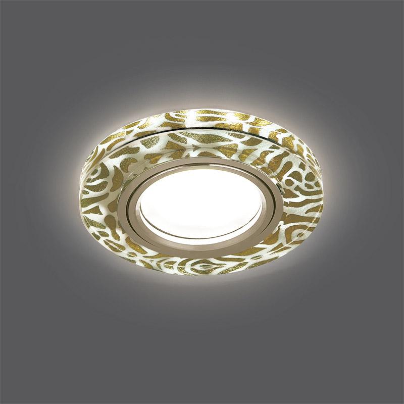 Точечный светильник BL064встраиваемые<br>Светильник Gauss Backlight BL064 Кругл. Золотой узор/Золото, Gu5.3, LED 2700K 1/40. Бренд - Gauss. тип лампы - галогеновая или LED. количество ламп - 1. тип цоколя - GU5.3. мощность лампы - 50. цвет арматуры - золотой. цвет плафона - золотой. материал арматуры - металл. материал плафона - стекло. высота - 35. ширина/диаметр - 95. длина - 95. степень защиты ip - 20. форма - круг. стиль - модерн. страна происхождения - Китай. монтажное отверстие - 65. коллекция - Backlight. напряжение - 220.<br><br>Бренд: Gauss<br>тип лампы: галогеновая или LED<br>количество ламп: 1<br>тип цоколя: GU5.3<br>мощность лампы: 50<br>цвет арматуры: золотой<br>цвет плафона: золотой<br>материал арматуры: металл<br>материал плафона: стекло<br>высота: 35<br>ширина/диаметр: 95<br>длина: 95<br>степень защиты ip: 20<br>форма: круг<br>стиль: модерн<br>страна происхождения: Китай<br>монтажное отверстие: 65<br>коллекция: Backlight<br>напряжение: 220
